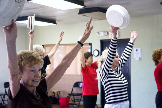 Happy Hoofers dancer Lu Johnson, 85, (front, left) strikes a pose during a dance number at a recent rehearsal. The group is made up of senior citizens.