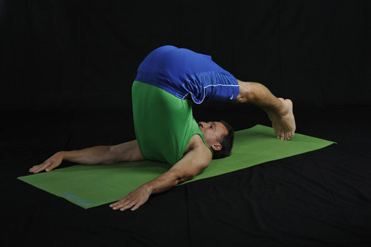 Stretches the shoulders & spine and reduces backache