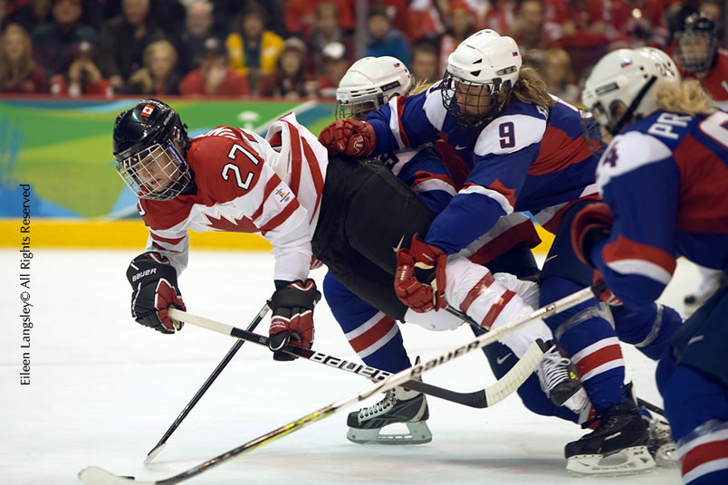 Canada's Gina Kingsbury takes a tumble after being tackled by Slovakia's Petra Babiakova in their match at the 2010 Winter Olympic Games in Vancouver.