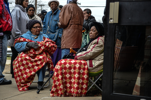 Over 240 Alexandrians wait in the cold outside Cora Kelly Recreation Center Saturday morning for ALIVE!'s Last Saturday Food Distribution, a program for families in need of assitance.