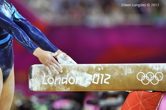 A cropped generic image of the hands of a gymnast ready to compete on Balance Beam at the London 2012 Olympic Games.