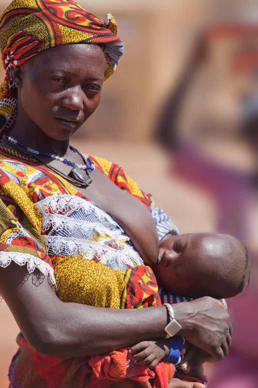 A Fulani woman breastfeeds her child in the weekly market of Djibo in northern Burkina Faso.