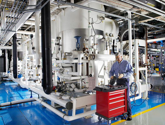 Merck pipefitter Edward Fink assembling actuator valve/ diaphram on water distillation equipment that is used in the purification process of water to be used in the production of vaccines. West Point building 60. Merck Manufacturing Division, BTMC Maintenance and Mechanical.