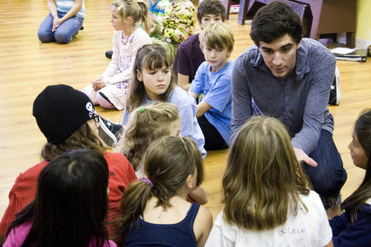 Adam Levy, 16, gives advice to younger MTA students during their rehearsal of My Son Pinocchio, Geppettos Musical Tale.