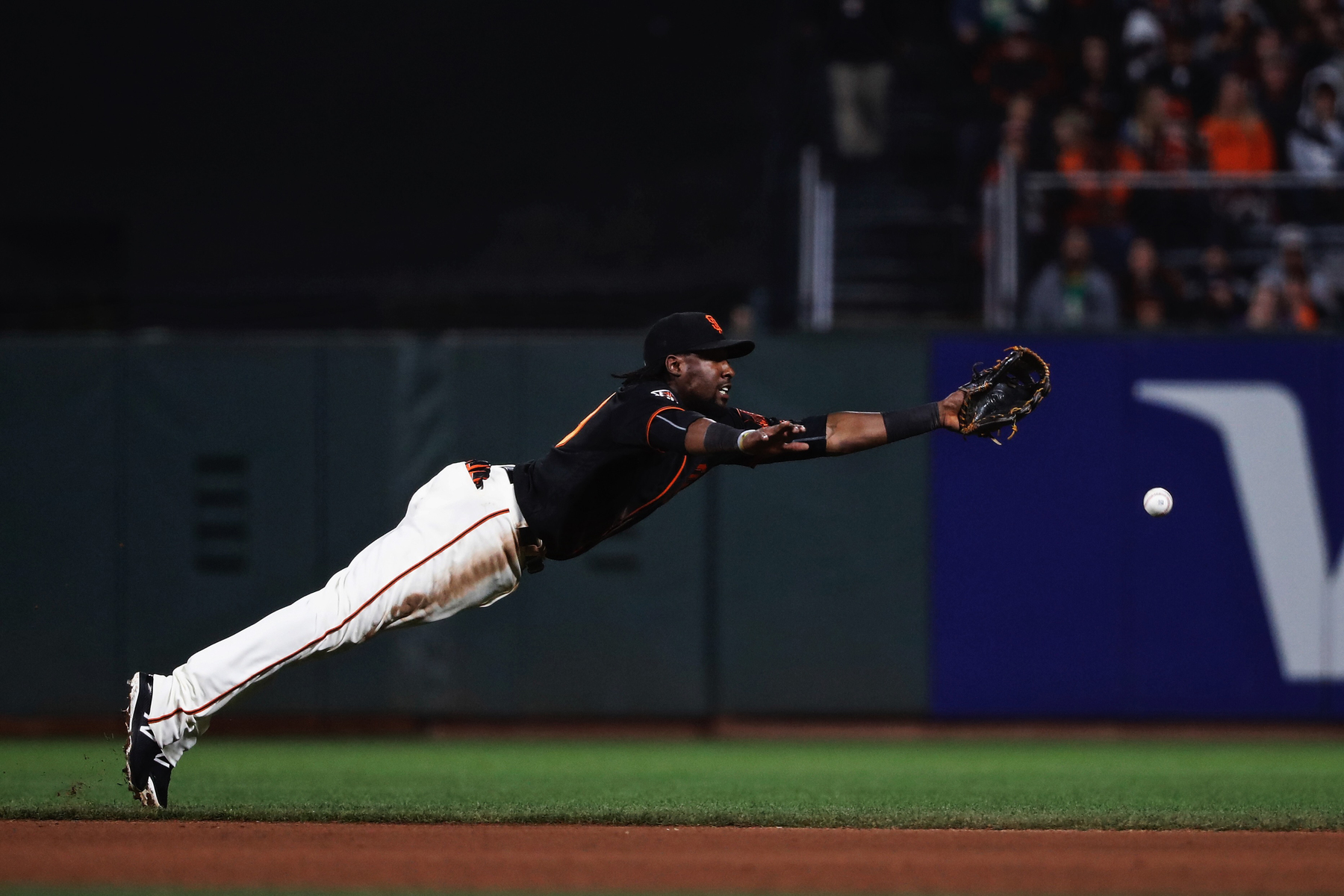 Alen Hanson #19 of the San Francisco Giants couldn't catch a ball hit by Josh Phegley #19 of the Oakland Athletics during the seventh inning of their MLB baseball game at AT&T Park on July 14, 2018 in San Francisco, California