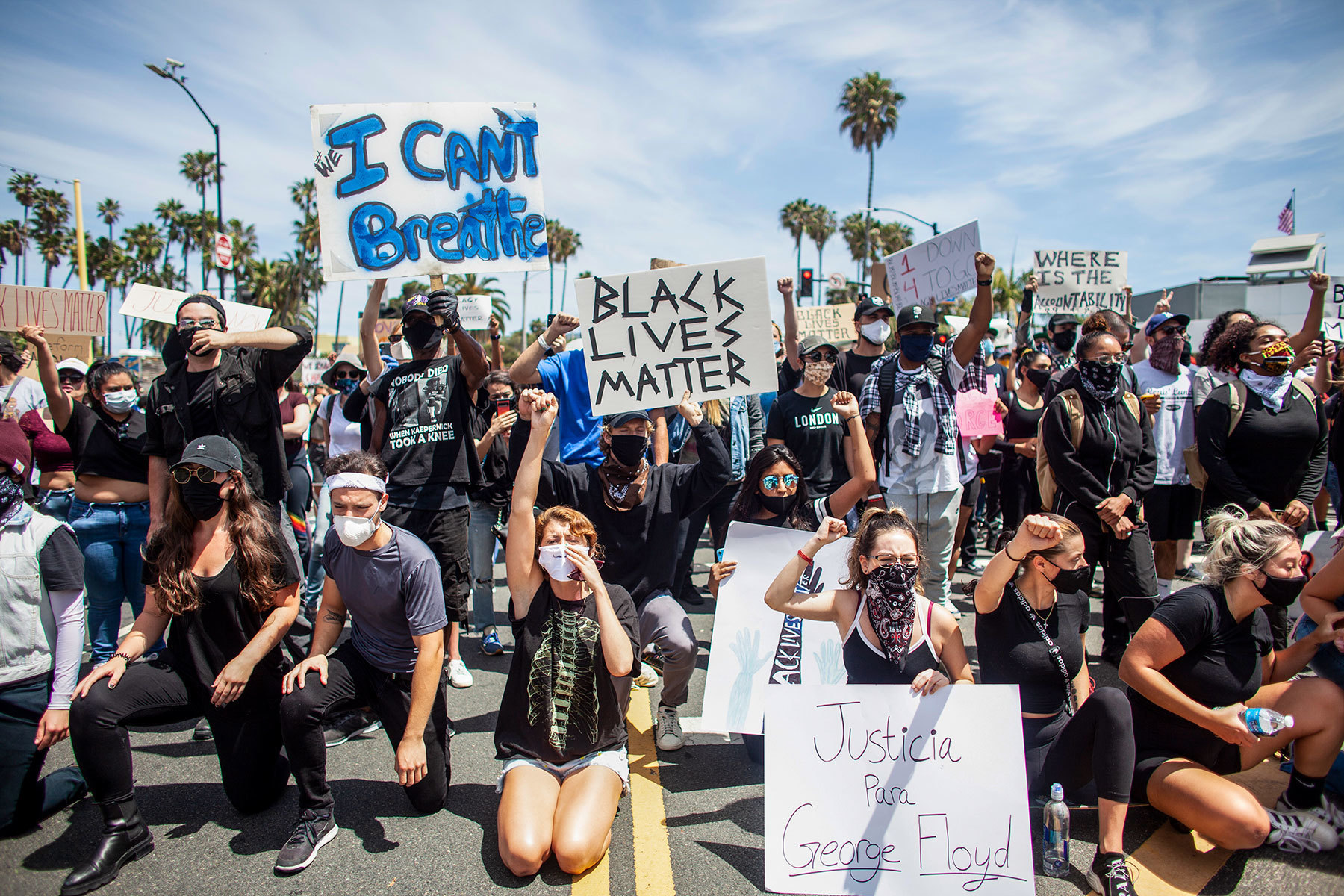 Protesters march in the streets of Santa Monica, California Sunday, May 31, 2020. The protests against police brutality were sparked by the death of George Floyd while in police custody in Minneapolis.
