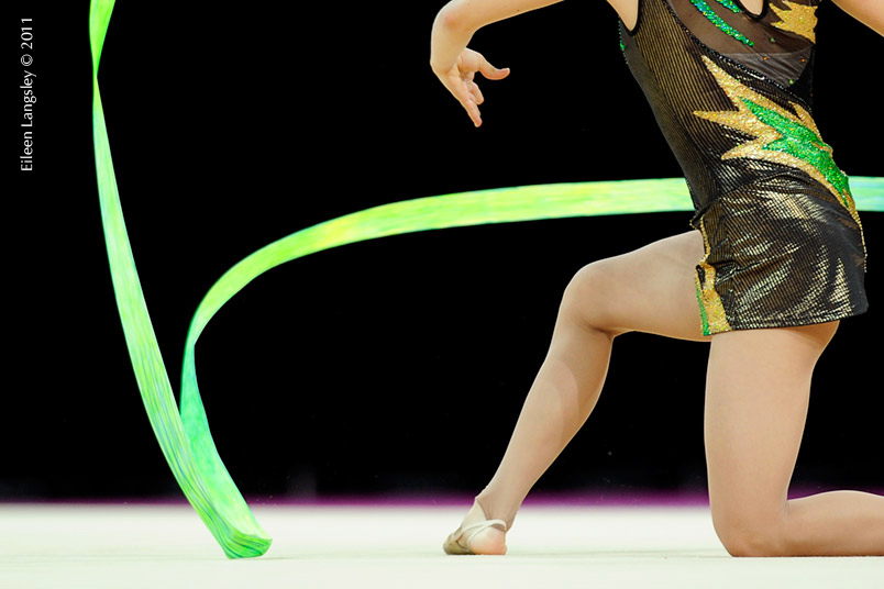 A cropped generic image of a gymnast competing with Ribbon at the World Rhythmic Gymnastics Championships in Montpellier.