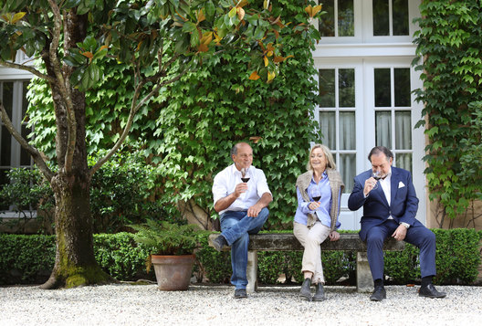 David Abreu (white shirt, blue jeans), Michel Rolland (blue suit) and Martha McClellan photographed at Sloan Estates.