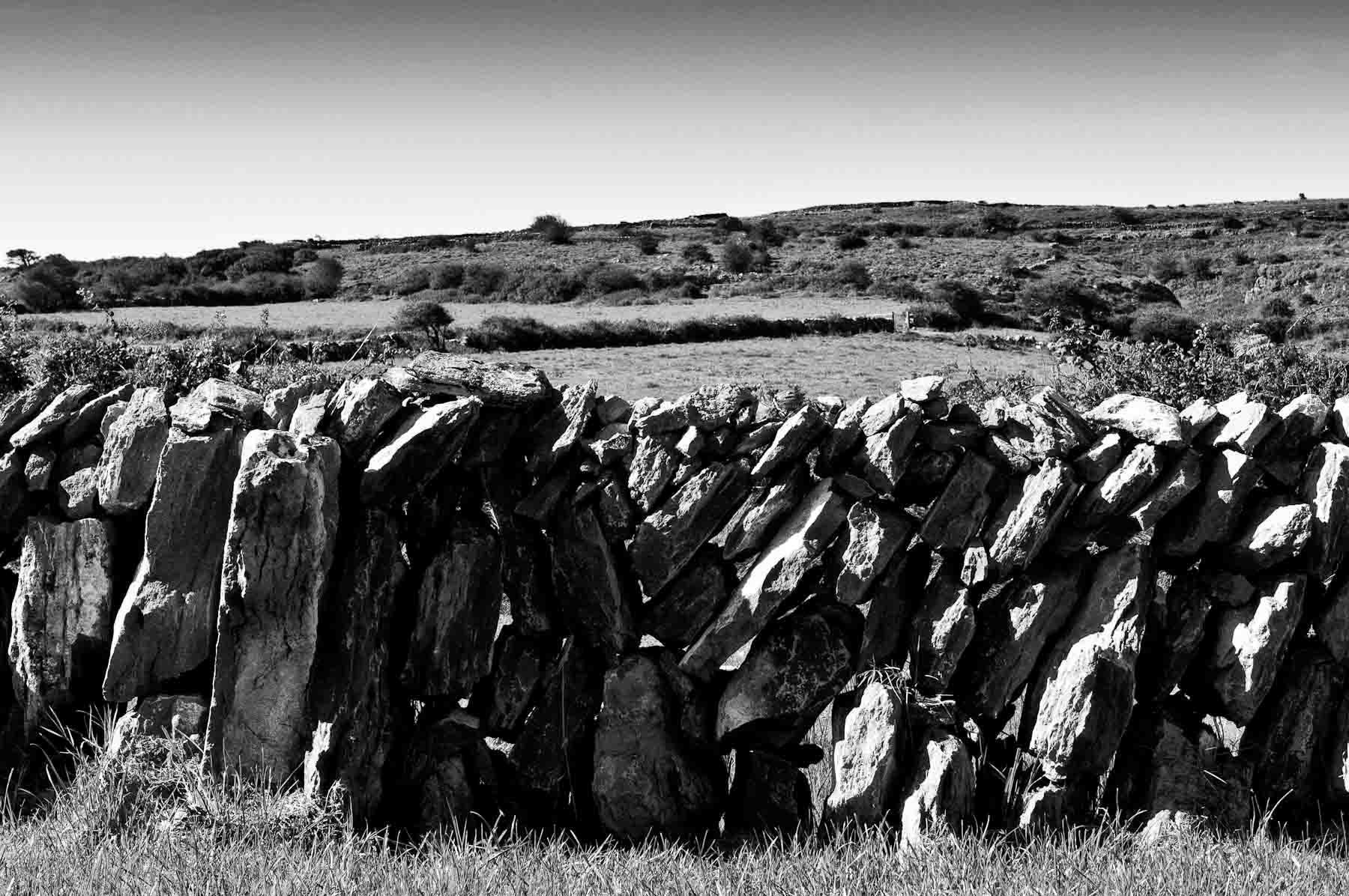 Loose rocks stacked to create a fence in Southern Ireland in 2009