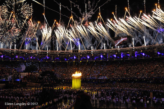 The Olympic Flame is lit and a firework display takes place during the Opening Ceremony at the London 2012 Olympic Games.