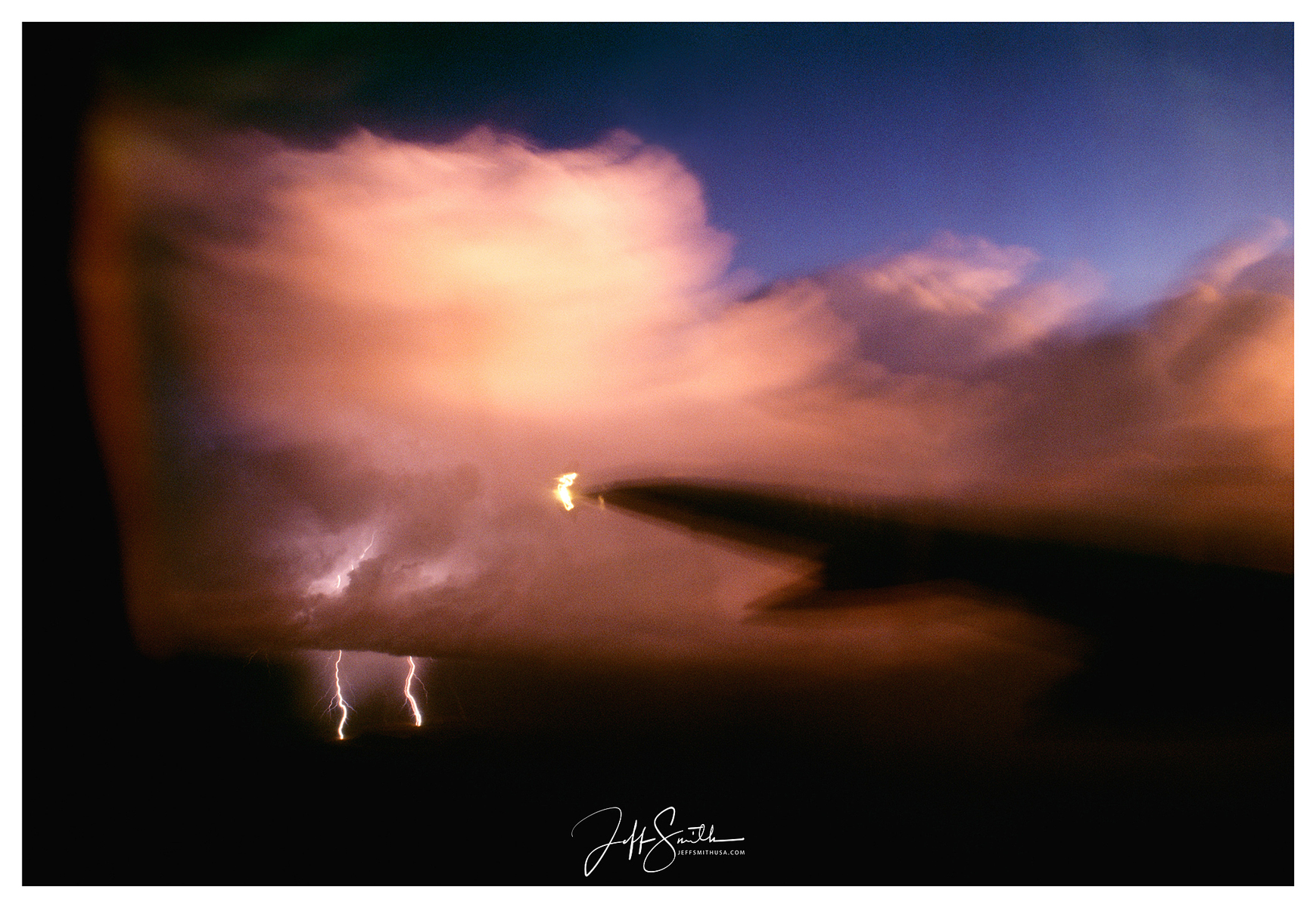 Flying into  Albuquerque, NM  at sunset I saw lightning in the distance towards the Santa Fe area.  I pushed my camera up against the window  opened the shutter momentarily and captured this.  1988 