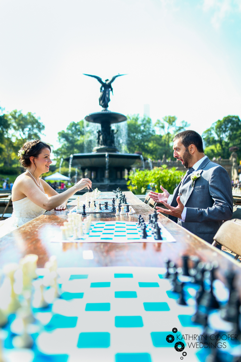 Central Park wedding photographer with couple playing chess -bride and groom chess players