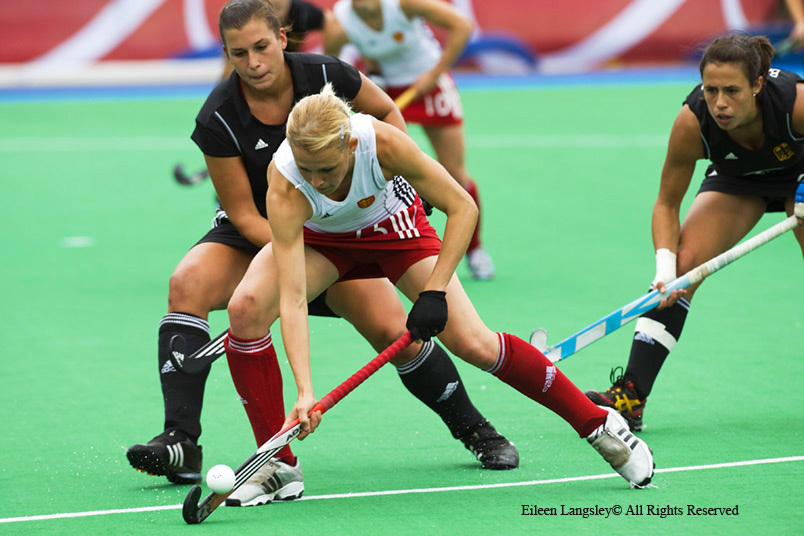 An action image of England's Alex Danson showing holding off opposition as she goes on the attack during the England Versus Germany match at the 2010 Women's World Cup Hockey Tournament in Nottingham