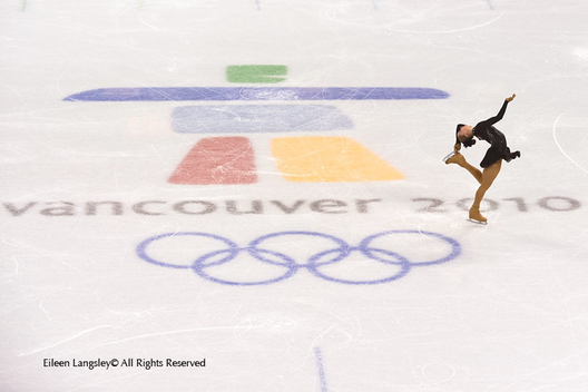 A generic imafe of a female figure skater perfroming a spin on the Olympic logo stained into the ice at the Pacific Coliseum at the 2010 Winter Olympic Games in Vancouver.