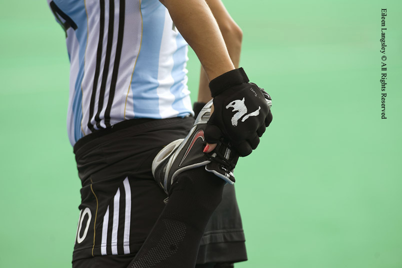 A cropped action portrait of an Argentinian player stretching her leg muscles before their match against China at the 2010 Women's World Cup Hockey Tournament in Nottingham.