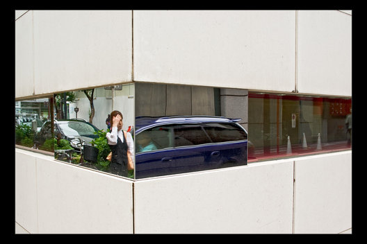 street life reflected in modern building, Tokyo