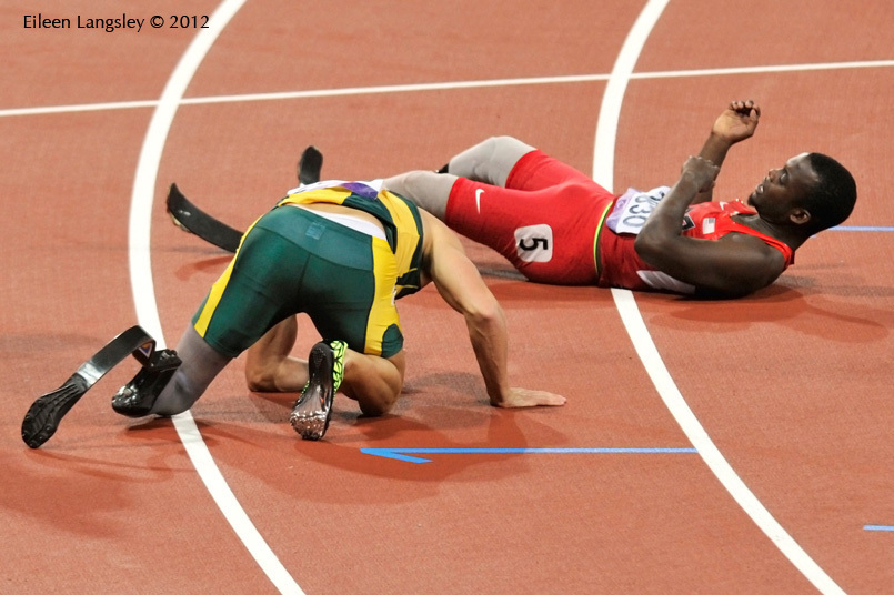 Amu Fourie (South Africa) and Blake Leeper (USA) take a tumble at the end of the final of the 200 metres T44 event in the Athletic competition at the London 2012 Paralympic Games.