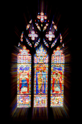 Washington, DC: October 11, 2008.  The Washington National Cathedral in Washington, DC boasts over 200 stained glass windows, many of which depict major events.  This image is a zoom burst of a stained glass window.  A zoom burst is done by zooming the zoom lens of the camera during a slow shutter speed exposure.