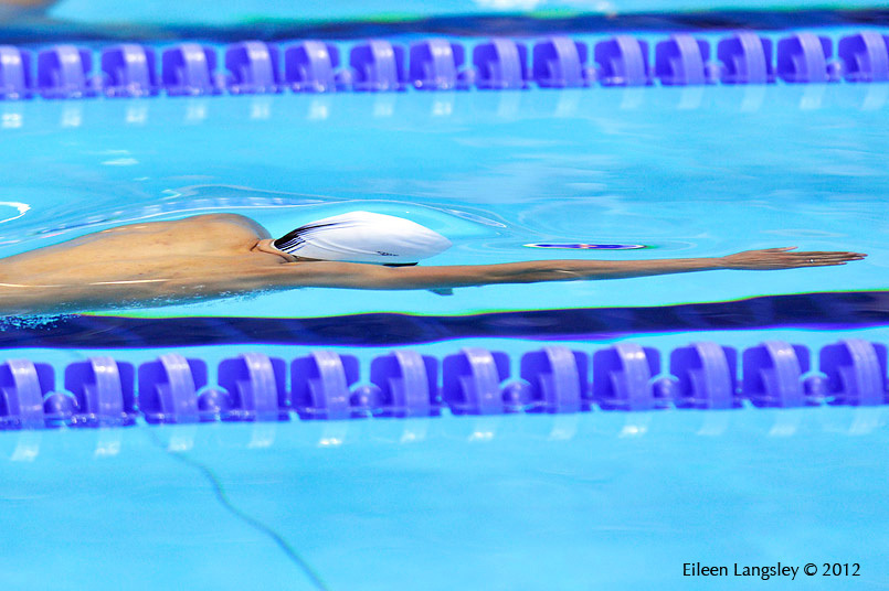 A generic blurred motion image of a disabled swimmer at the London 2012 Paralympic Games.