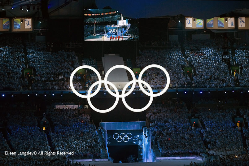 An image from the Opening Ceremony of the 2010 Winter Olympics in Vancouver with Olympic Rings featuring in the decoration of BC PLace and on the live view video screen.