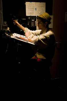 Adam Levy, 16, goes over his lines as Geppetto as he waits backstage.