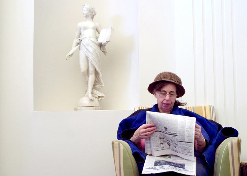 Greenville resident Constance Bashore reads a paper at the Greenville Public Library on March 10. Bashore, who has been visiting the library several times a week for many years, said she has seen an increase in visitors since the economy has gone down.