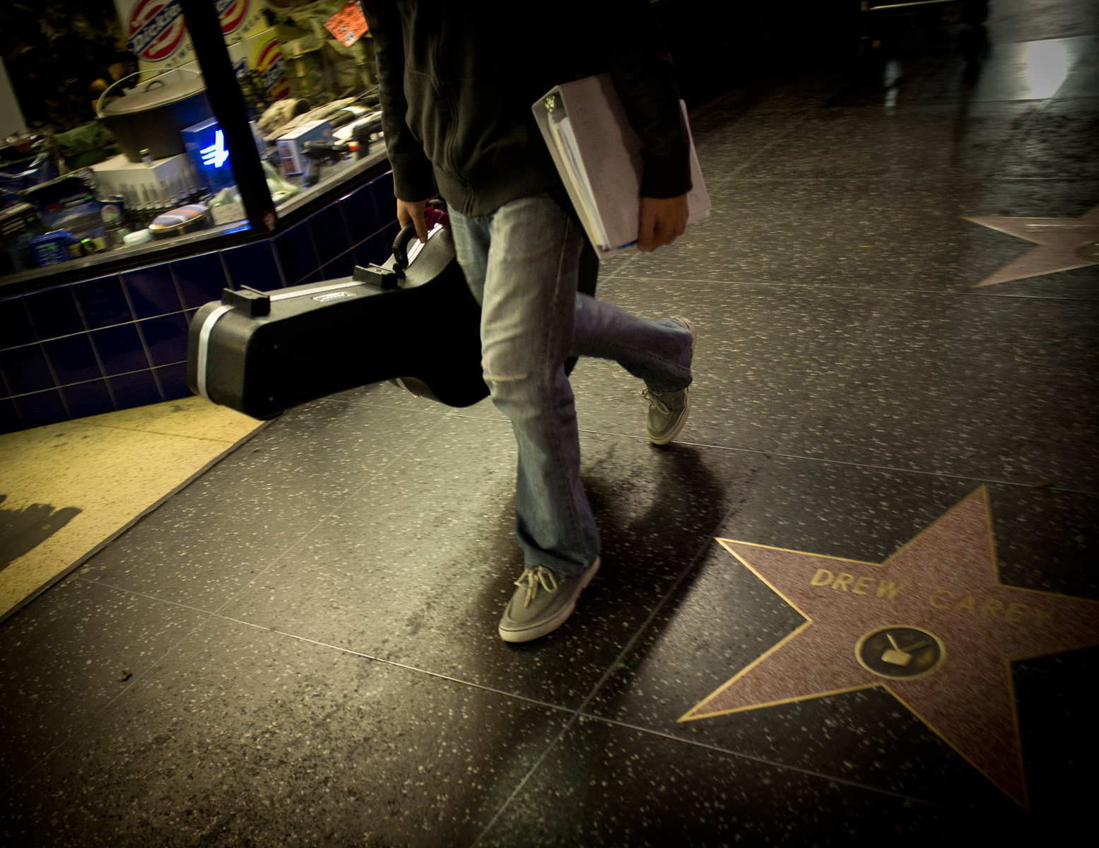 A Hollywood hopeful pounds the streets of Hollywood Boulevard in search of his dreams. Hollywood, Ca.
