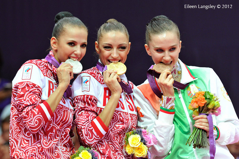 Evgeniya Kanaeva, Daria Dmitrieva (Russia) and Lioubou Charkashyna (Belarus) with their medals from the all around of the Rhythmic Gymnastics event at the 2012 London Olympic Games.