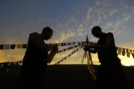 Tibetan monks hang prayer flags during a visit to Aspen, Colorado.  Michael Brands, 2008