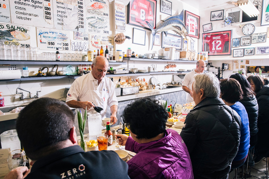 Steve Sancimino, left, and Kevin Sancimino work behind the counter at Swan Oyster Depot in San Francisco, Calif. on Tuesday, April 2, 2019.