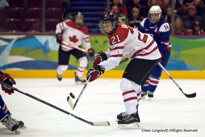 Canada's Haley Irwin shows close control of stick and puck during their match against Slovakia at the 2010 Winter Olympic Games in Vancouver.